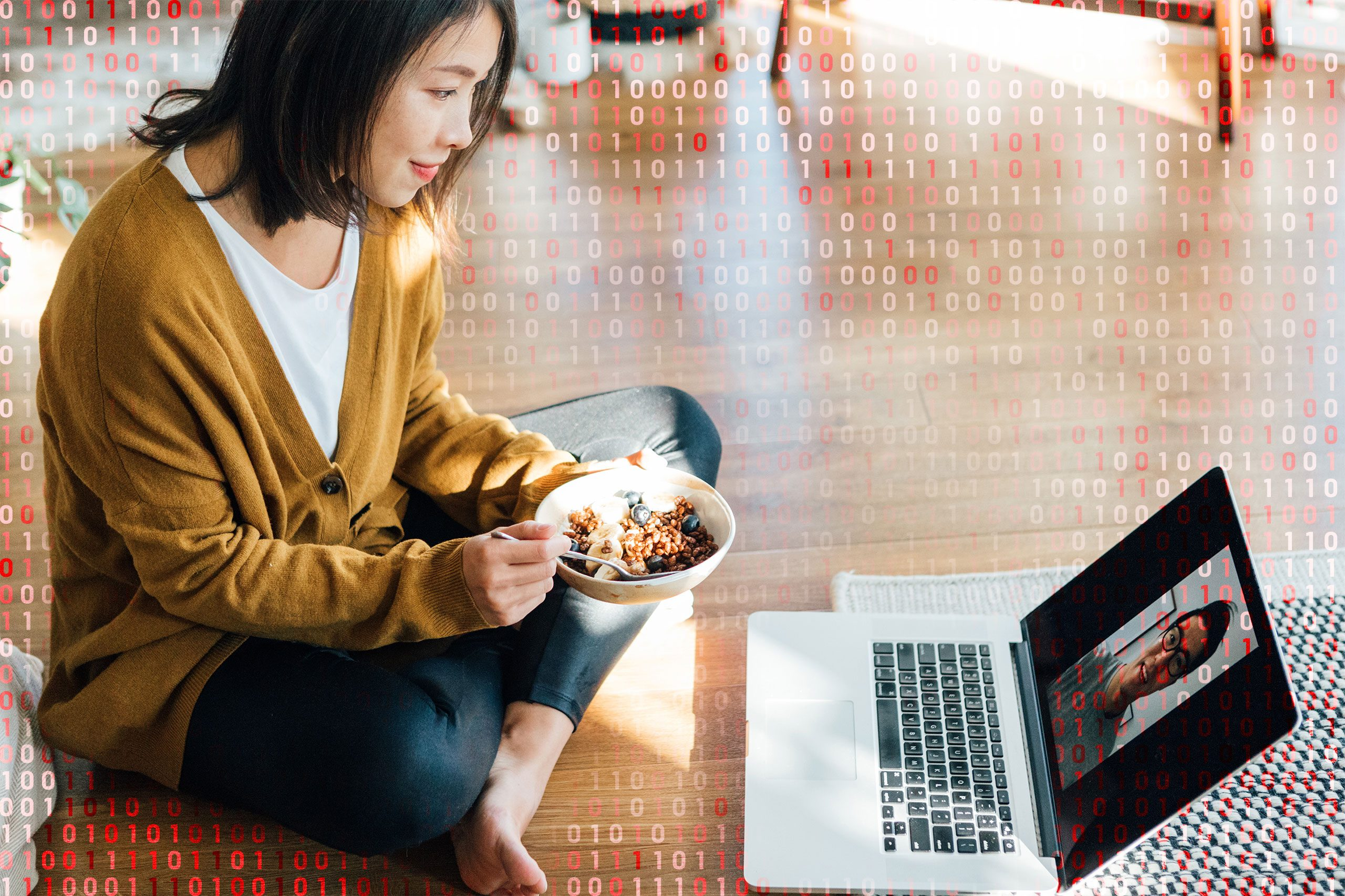 woman eating cereal while using zoom; computer code overlay