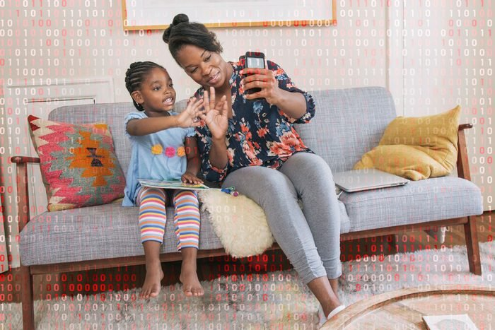woman and daughter using zoom; computer code overlay