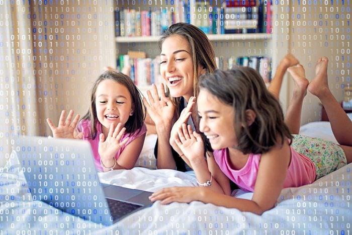 family using zoom; computer code overlay