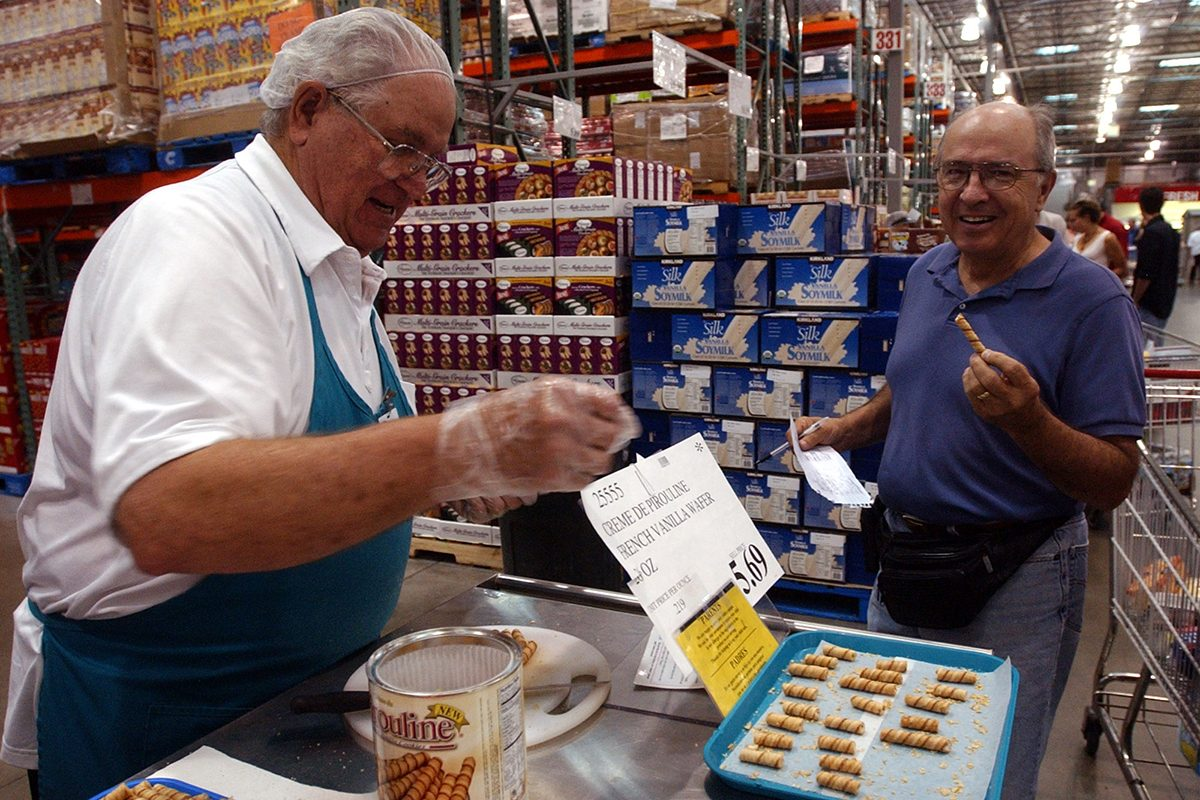 Vaughn Fish (cq) left, offers sample of food to Buz Smith Saturday at Costco. This is a slice on the Costco culture.(Photo by Cliff Grassmick/Digital First Media/Boulder Daily Camera via Getty Images)