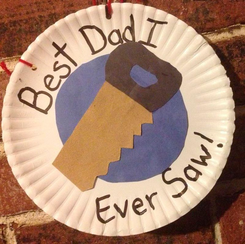 Fathers Day Craft with a construction paper saw on a paper plate