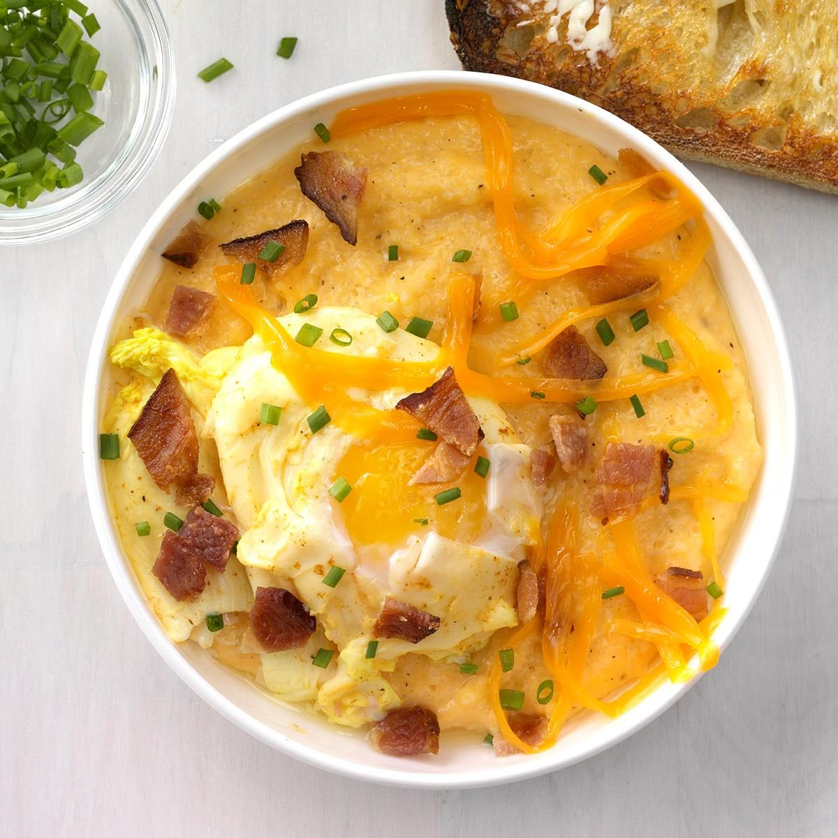 creamy cheesy grits with curried poached egg