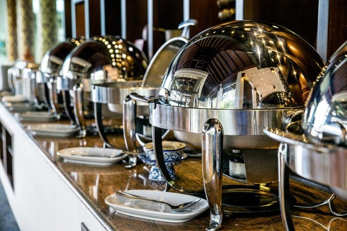 Catering buffet food with heated trays ready for service