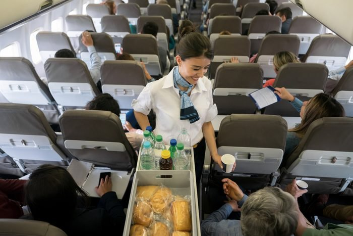 Air hostess serving food and drinks onboard