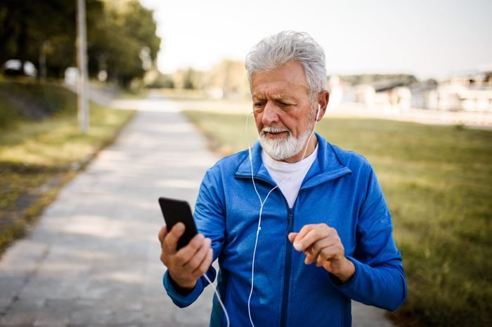 Senior man using mobile phone.