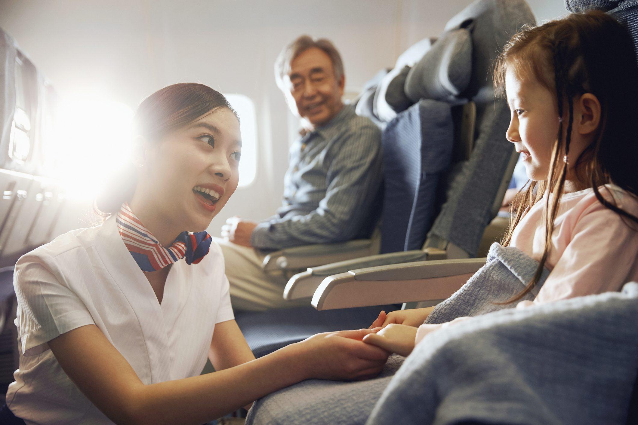 Flight attendants and passengers on the plane