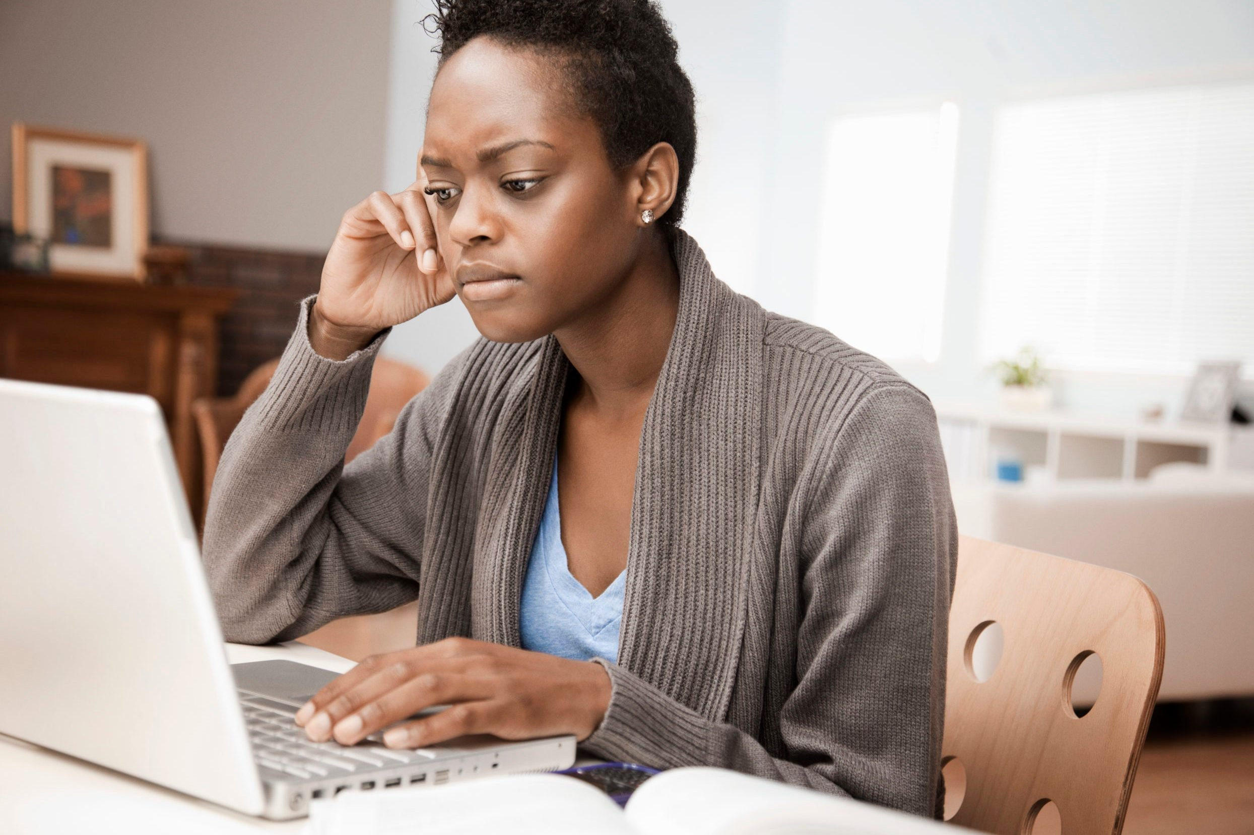 African American woman working in home office