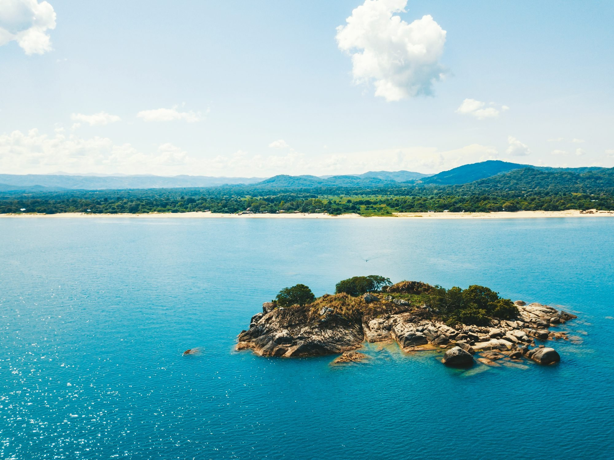 lake malawi with tiny island in the