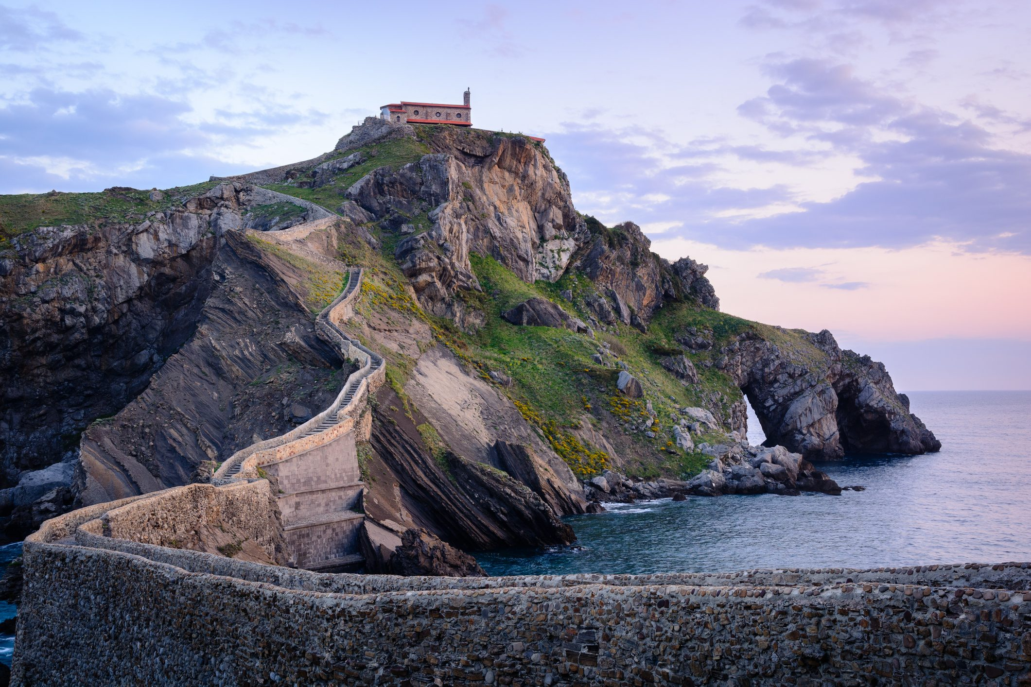 Hermitage of San Juan de Gaztelugatxe in the Basc Country at the sunrise.