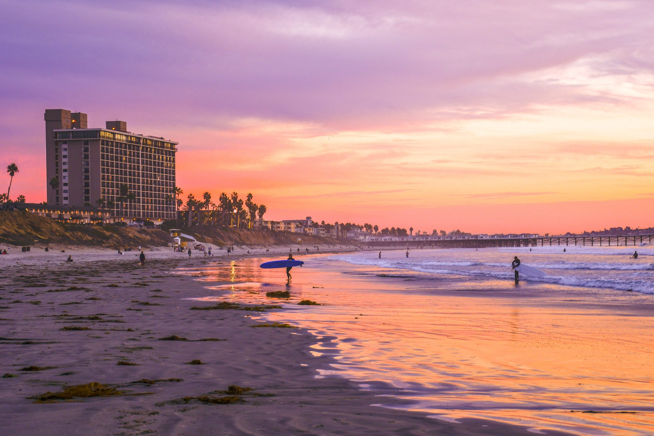 Surfers and Pink Sunset at Pacific Beach