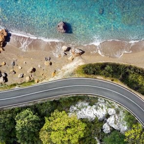 Seaside road approaching a beach, seen from above