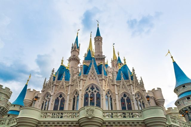 The Cinderella Castle during an overcast day is seen in the...