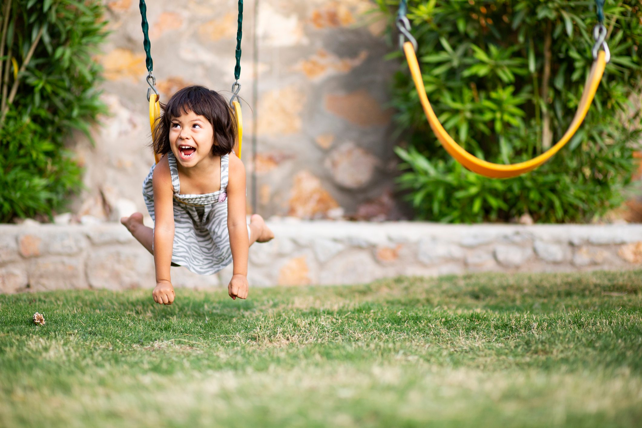 Girl Swinging on Her Tummy Laughing