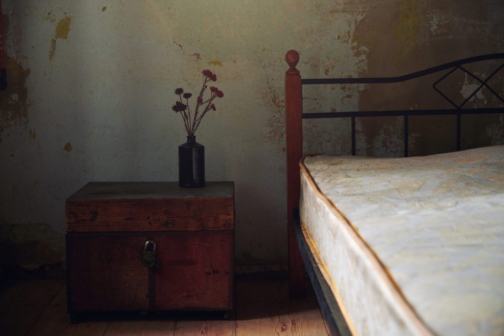 Vintage interior with bed and wooden trunk. Nicely fits for book cover