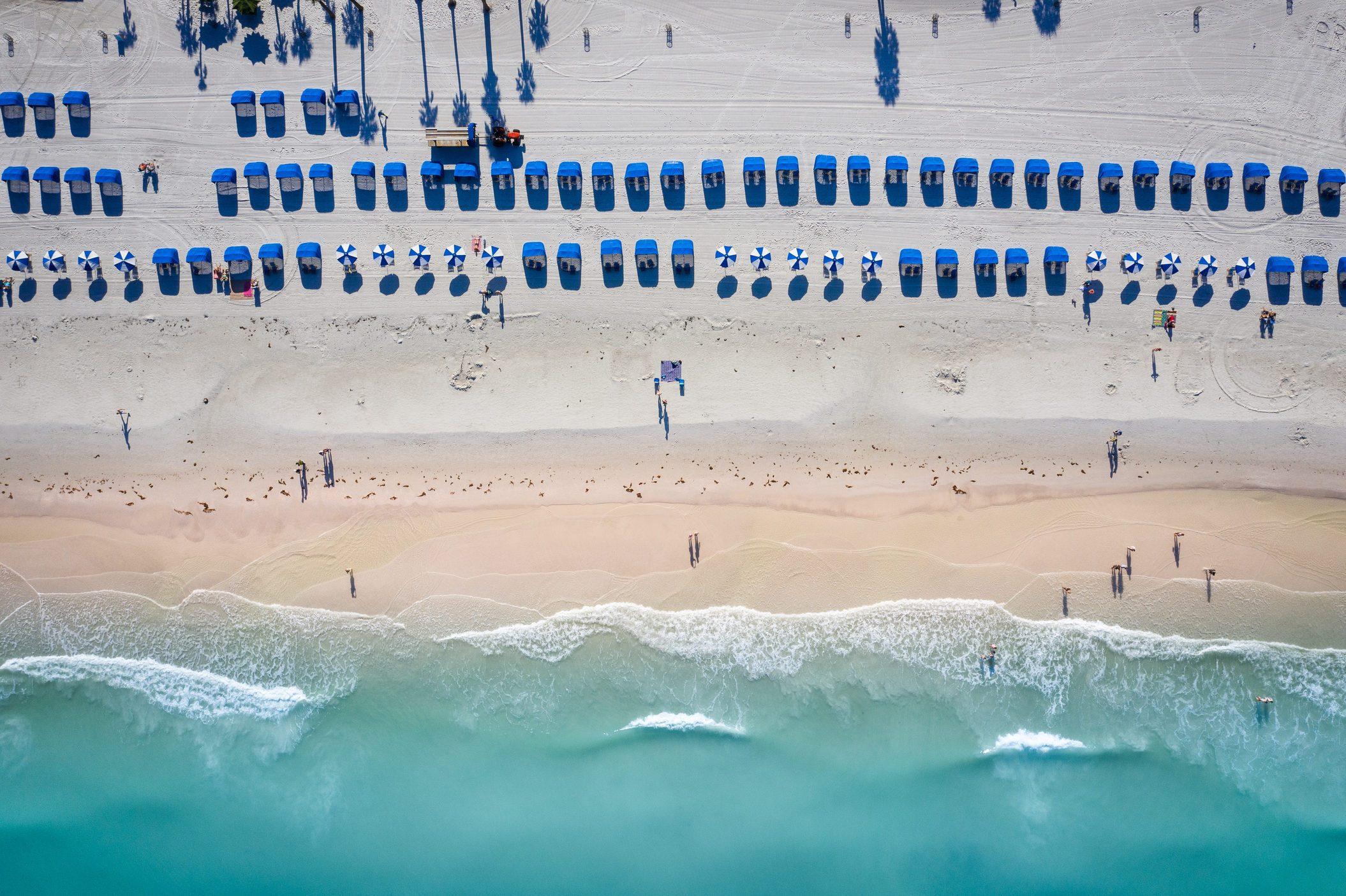 Aerial View Of Umbrellas On Beach