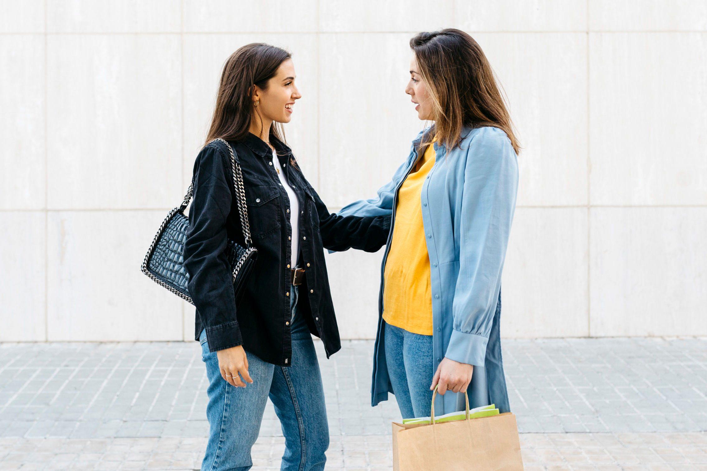 Two women talking during shopping