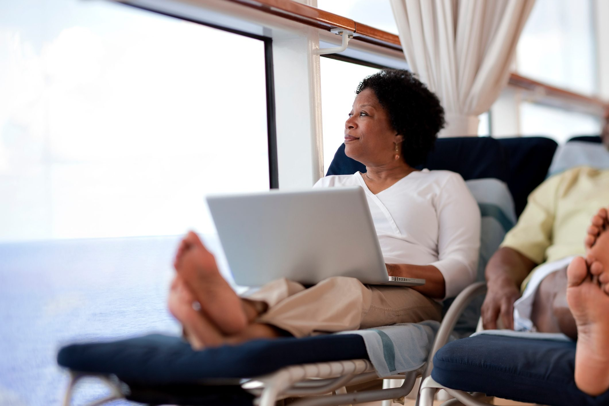 Woman on lounge chair with laptop