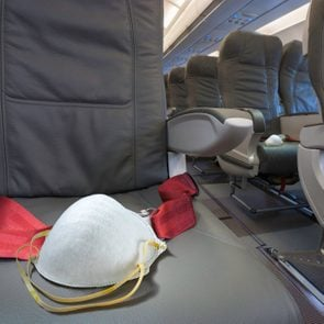 Face mask on airplane seat