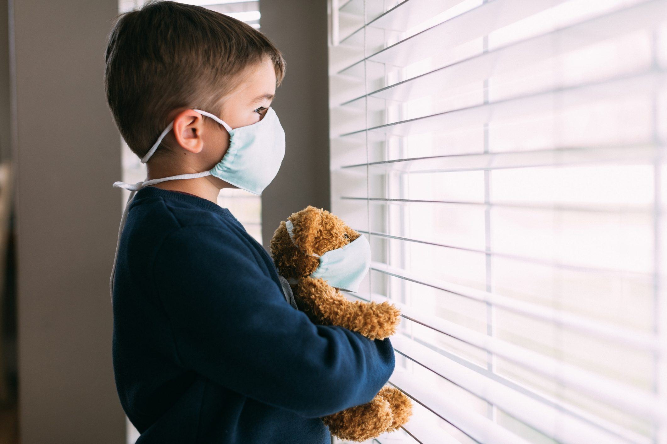 Young Boy and his Teddy Wearing Face Masks