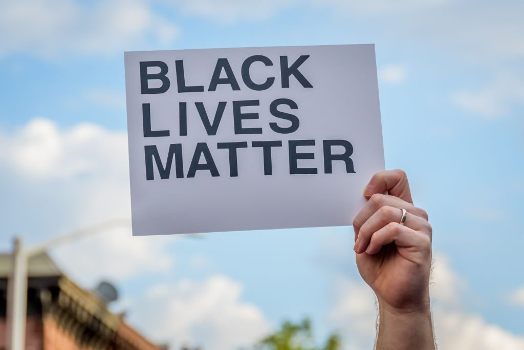 A participant holding a Black Lives Matter sign at the...