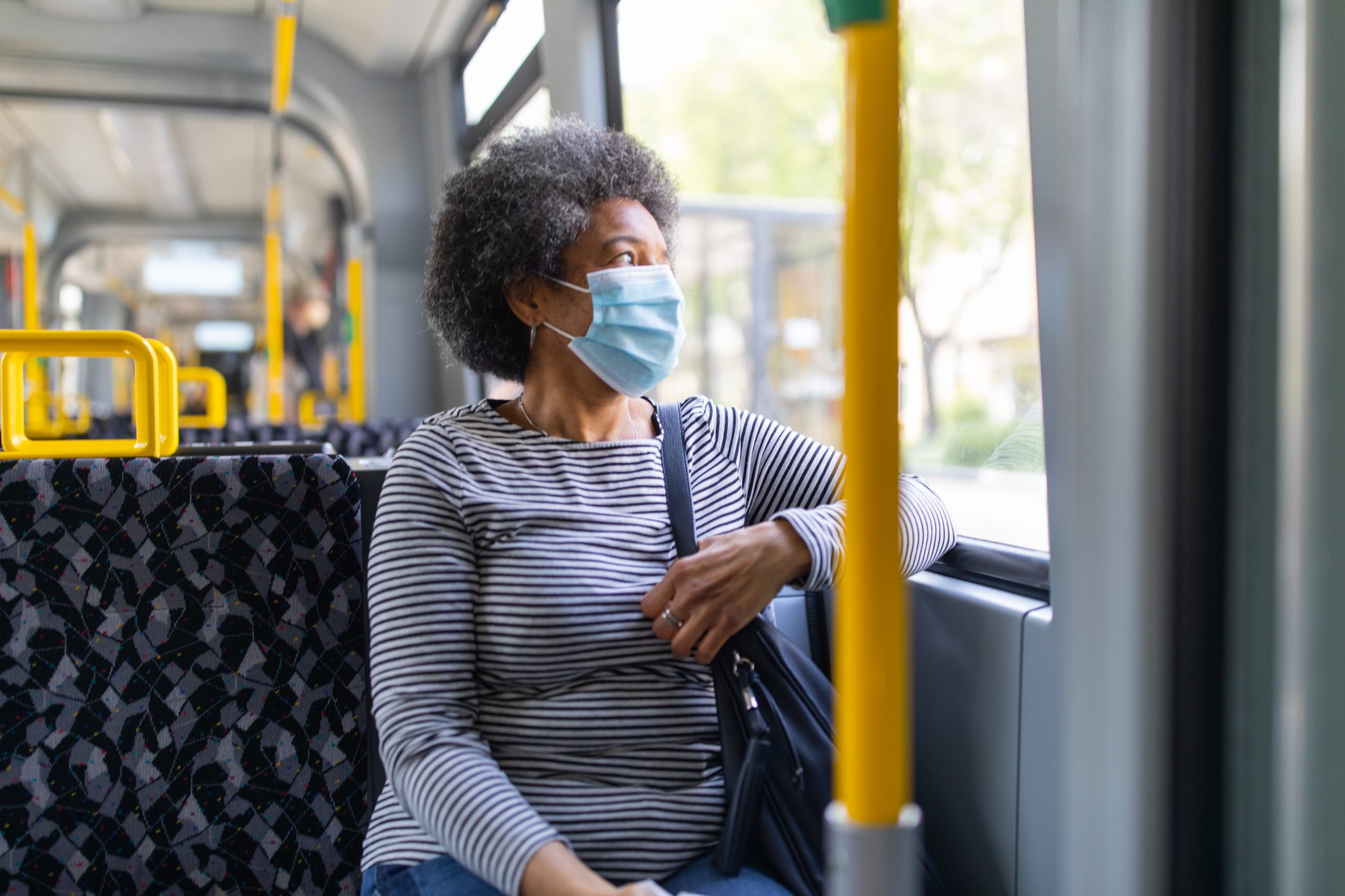 Woman with face mask travelling in the tram during Covid-19 outbreak