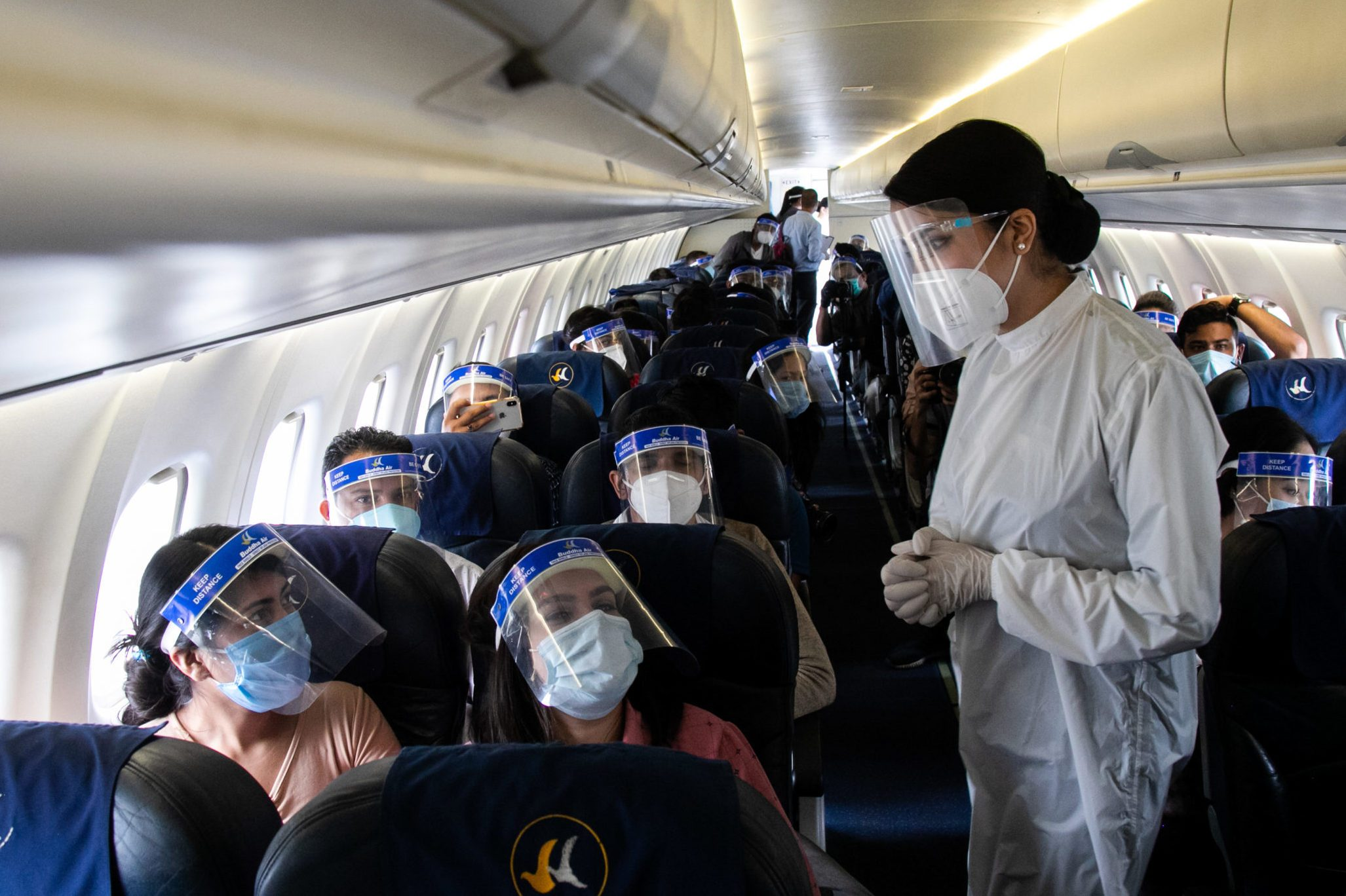 An air hostess of Buddha Air wearing a protective suit...