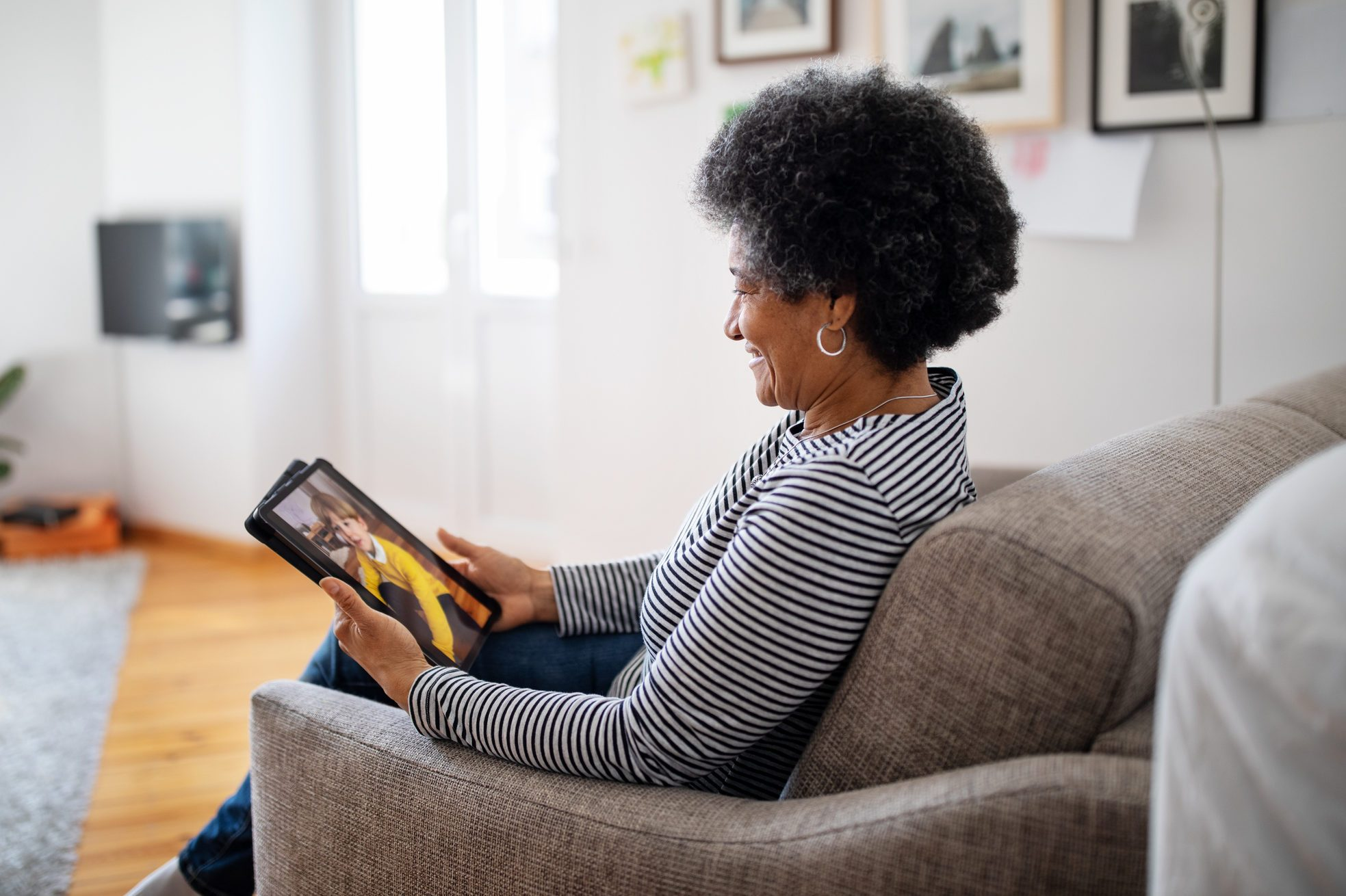 Mature woman having video call with family during covid-19 pandemic