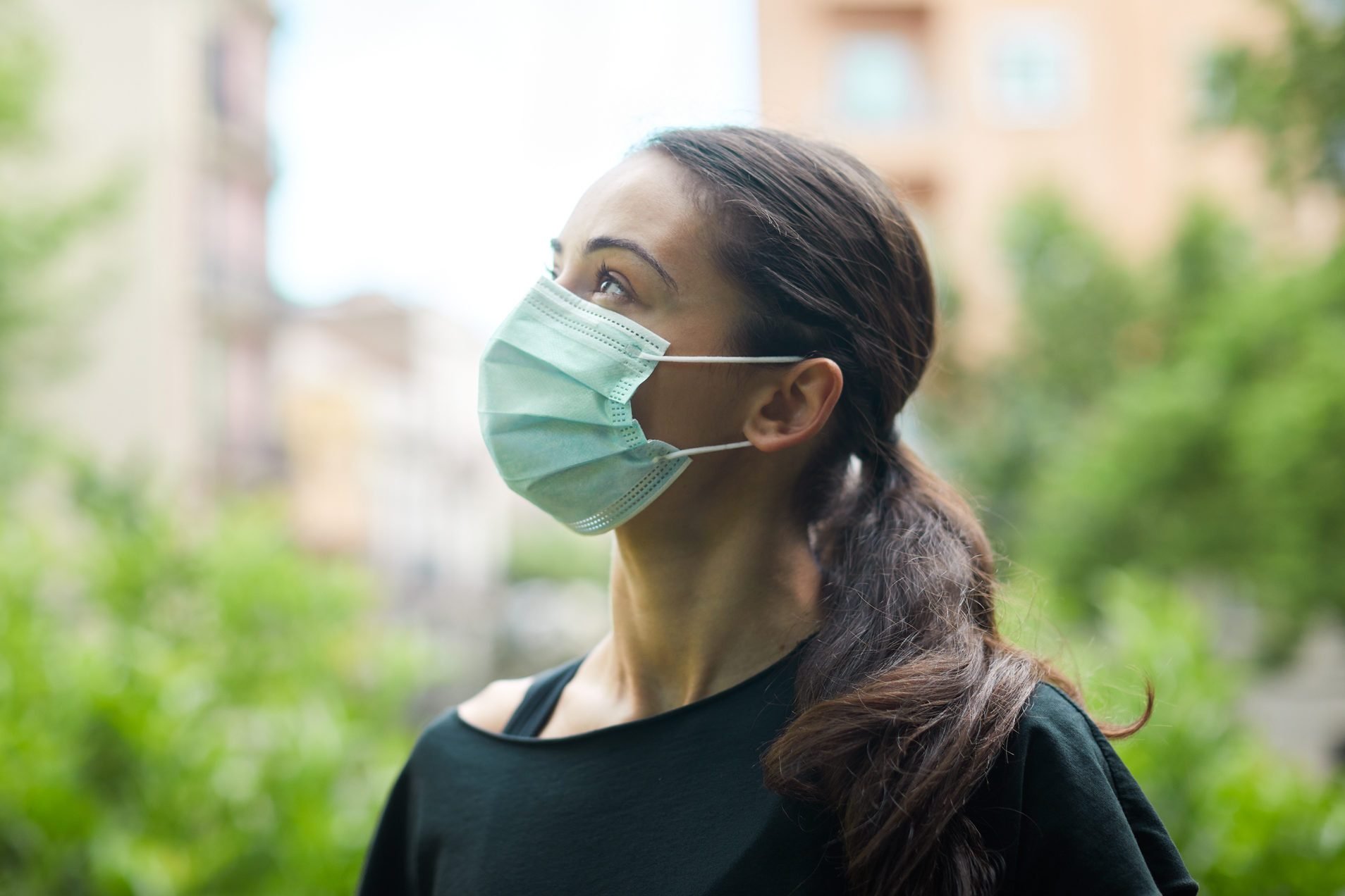 One young woman wearing a surgical mask outdoor