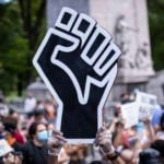 The History Behind the Clenched First—And How It Became the Symbol for Black Power