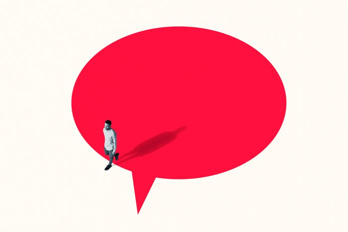 Man walking out from vibrant red speech bubble