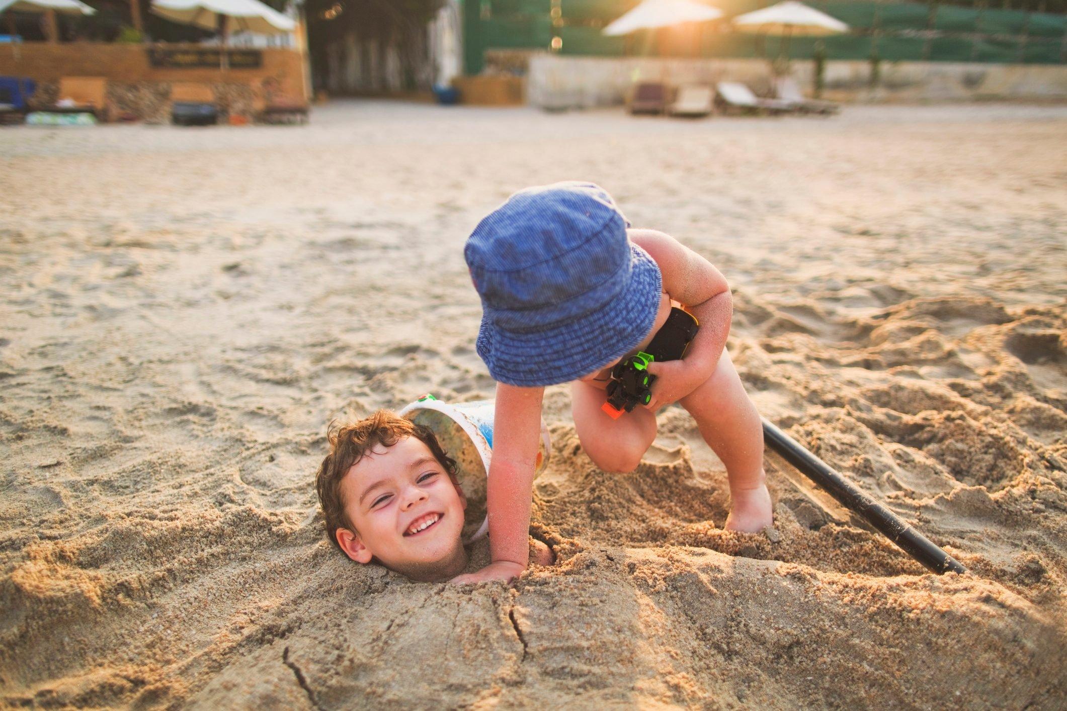 Little cute boys on the sea beach.
