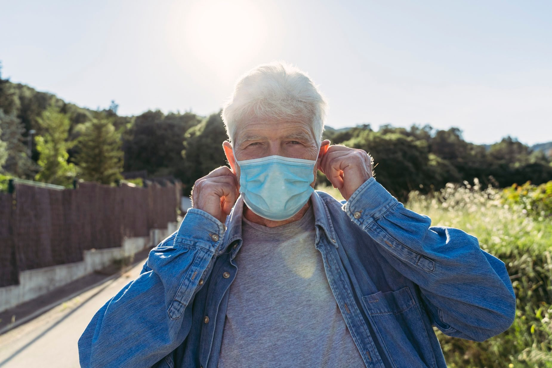 Senior man with protective mask outdoors
