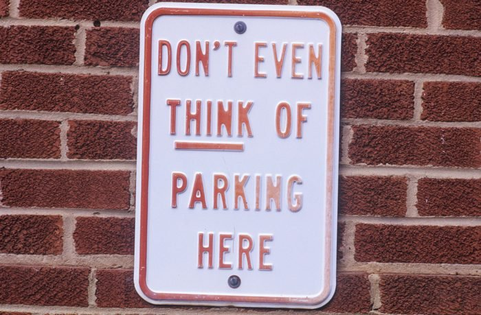 """A sign that reads """"Don't even think of parking here"""""""