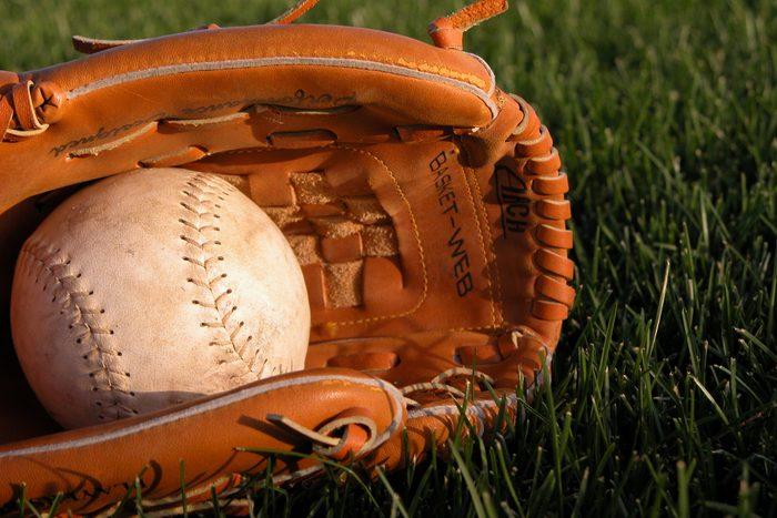 Baseball Glove Holding Softball