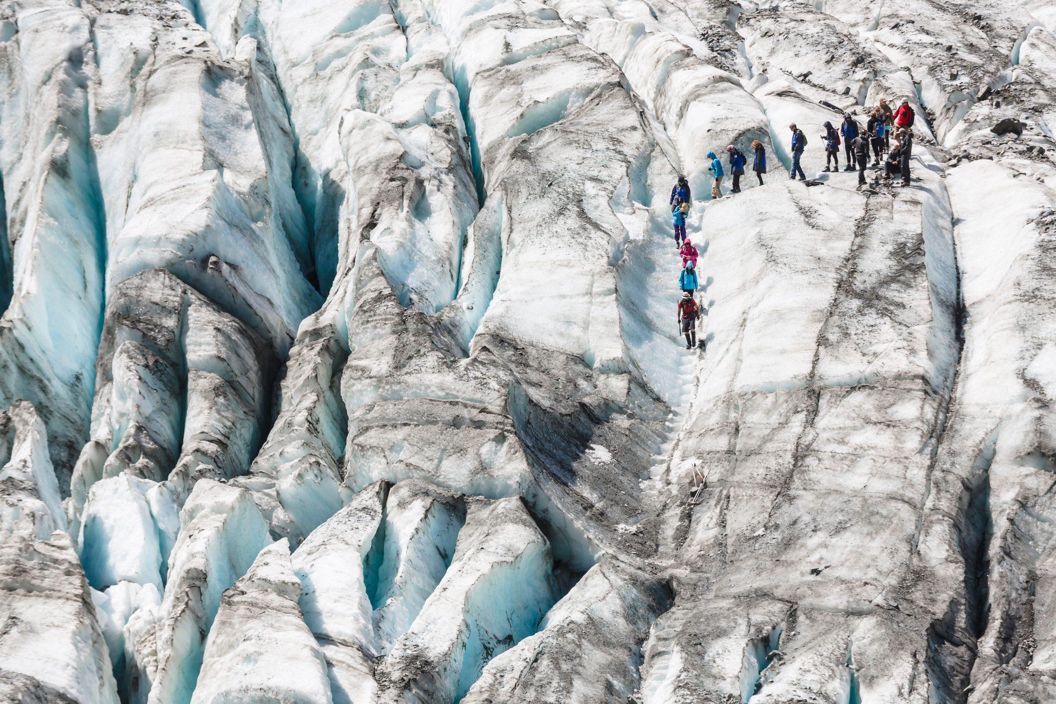 Tourists hiking on Fox Glacier.
