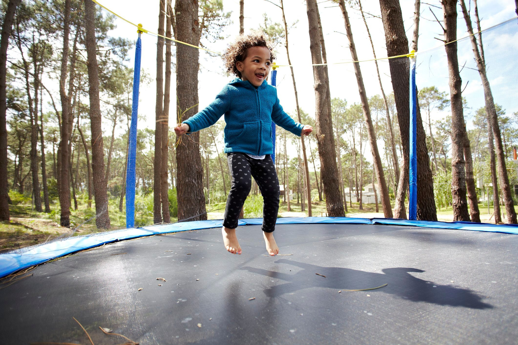 child jumping on the trampoline