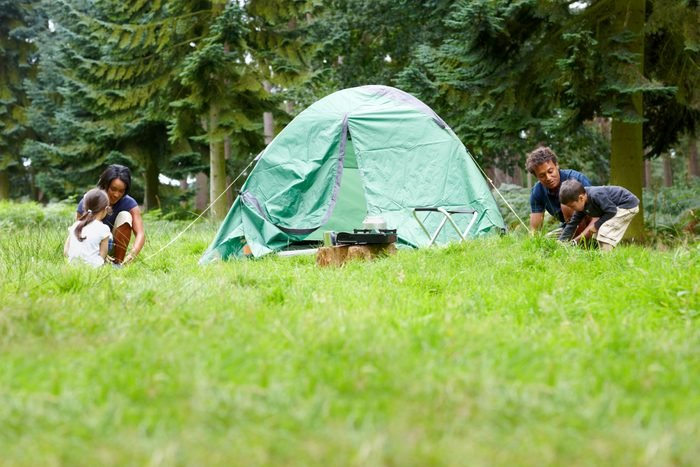Family setting up tent