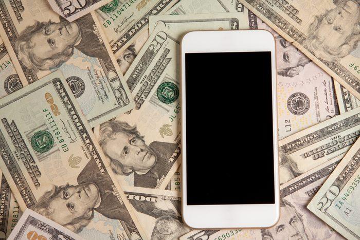 Smart Phone Laying On Money