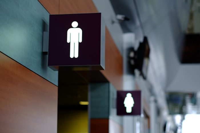entrance to the male and female toilet. Sign in airport