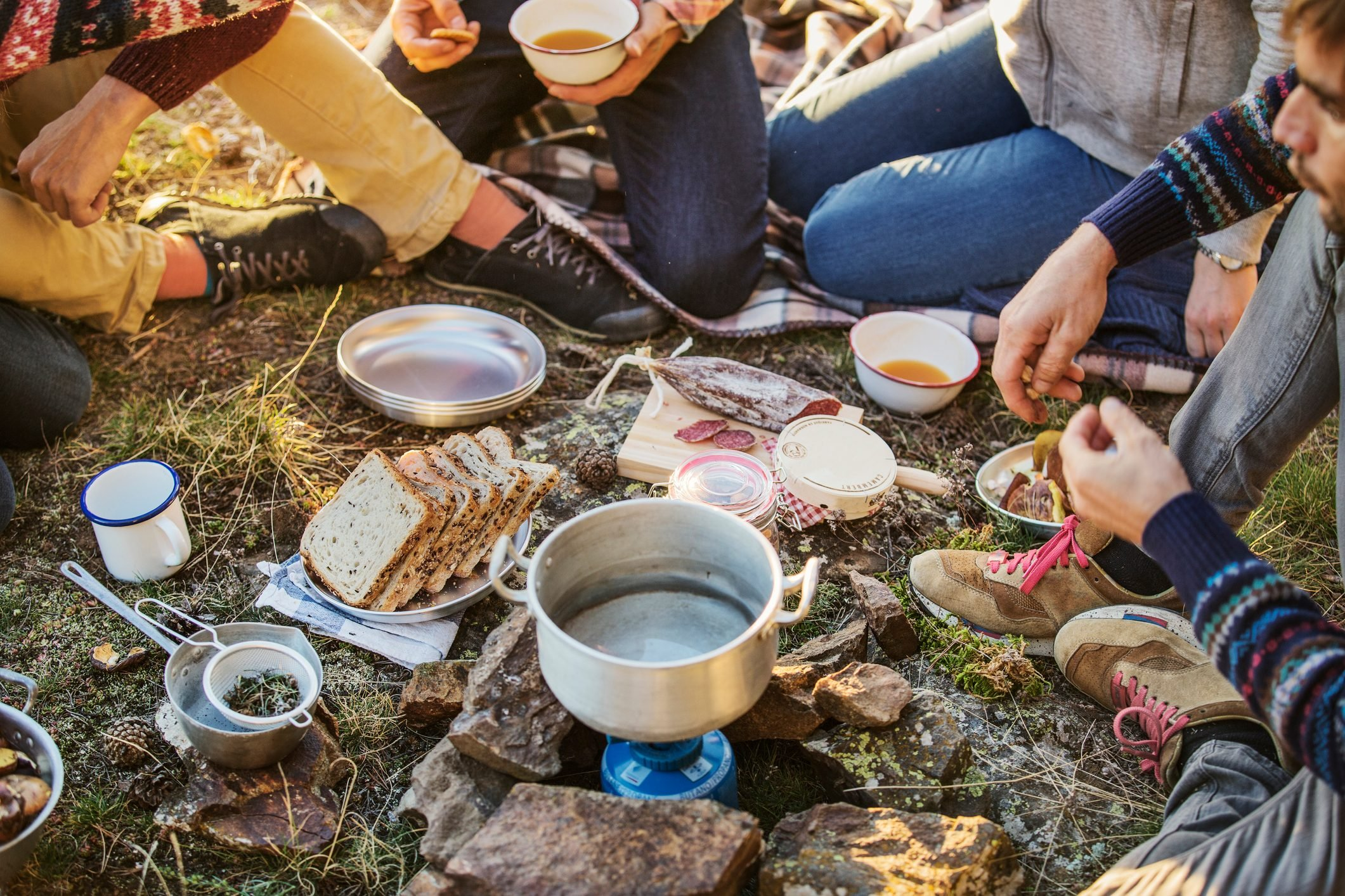 Friends preparing breakfast at campsite