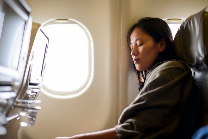 Woman sleeping on airplan