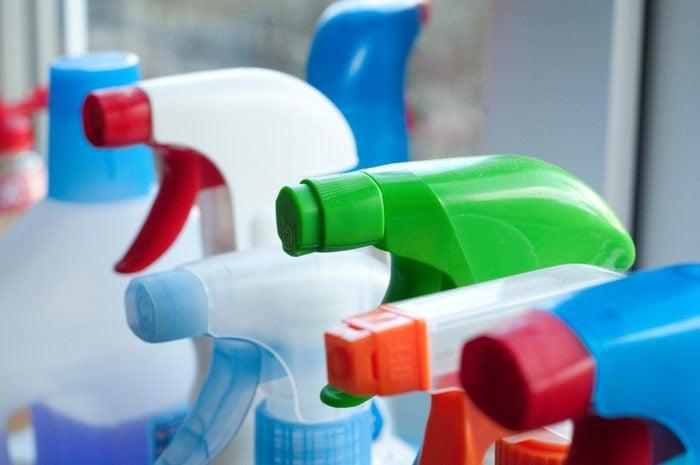 Close-Up Of Spray Bottles In Kitchen