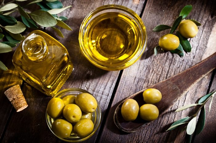 Olive oil and green olives shot from above