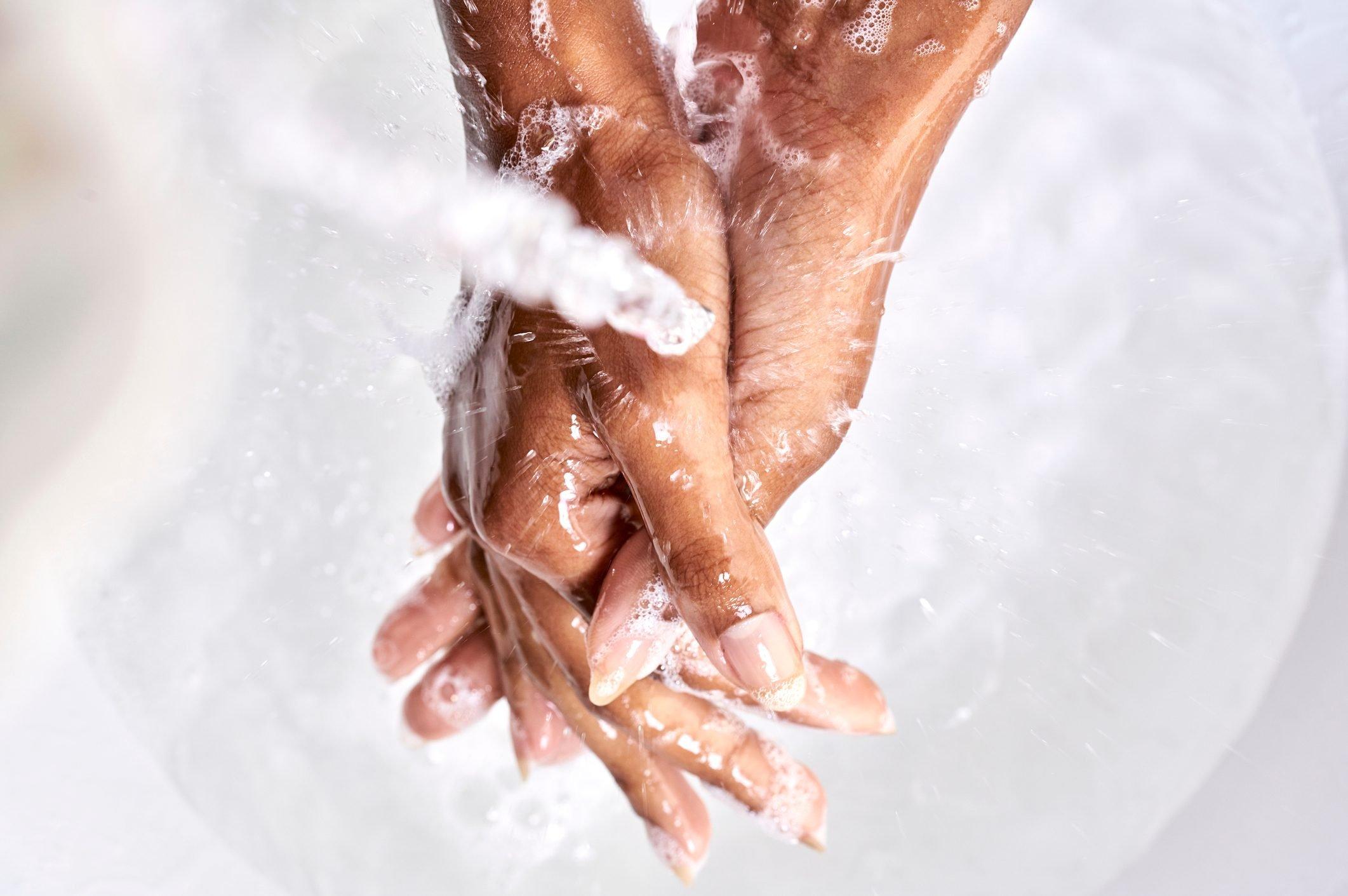 close up of a black woman washing hand