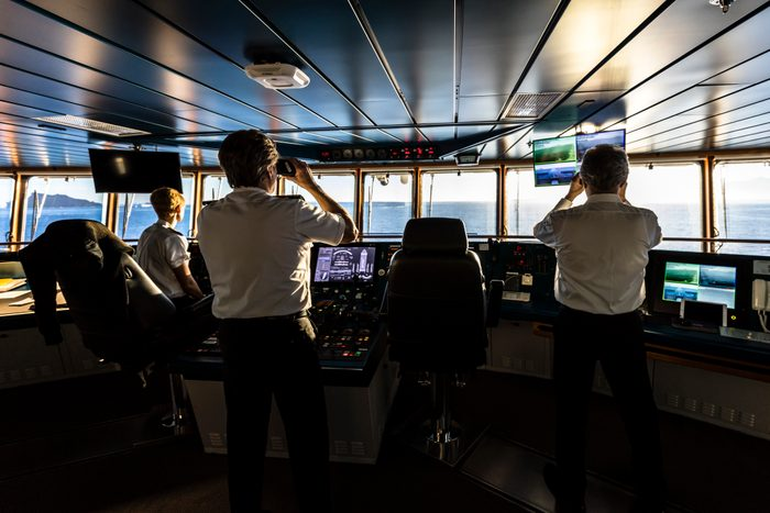 Captain and officers on the bridge of a ship.