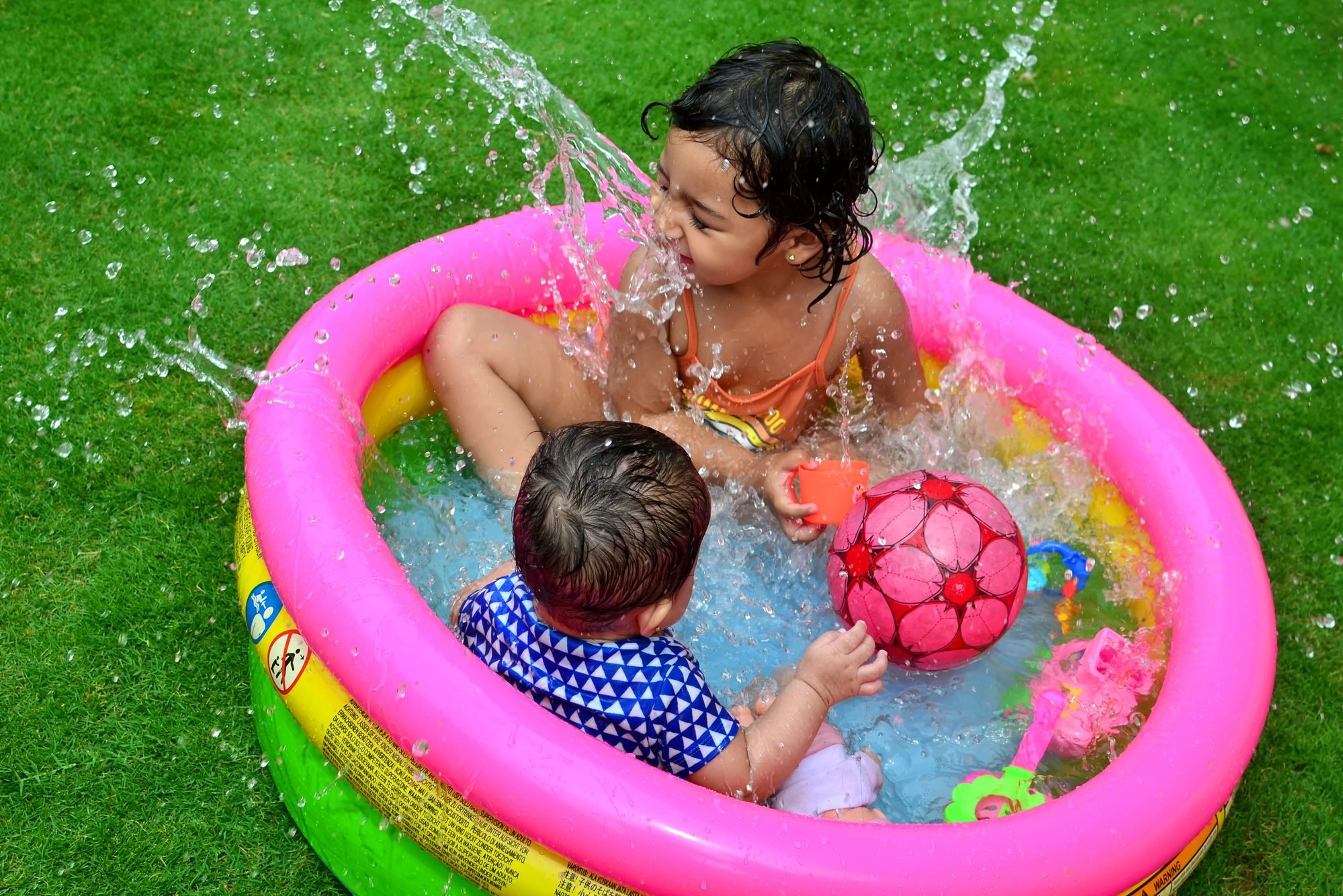 High Angle View Of Children Playing In Pool