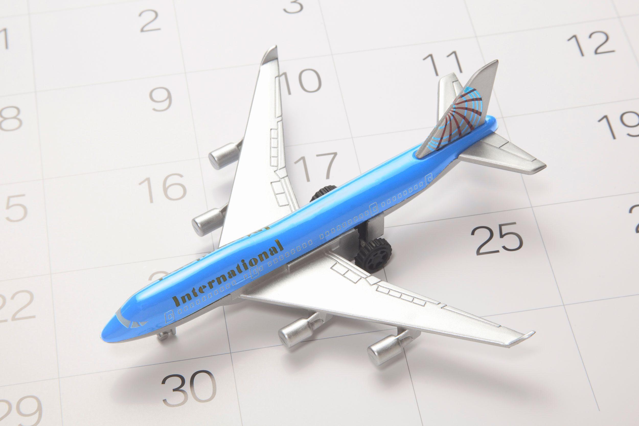 toy airplane on calendar background