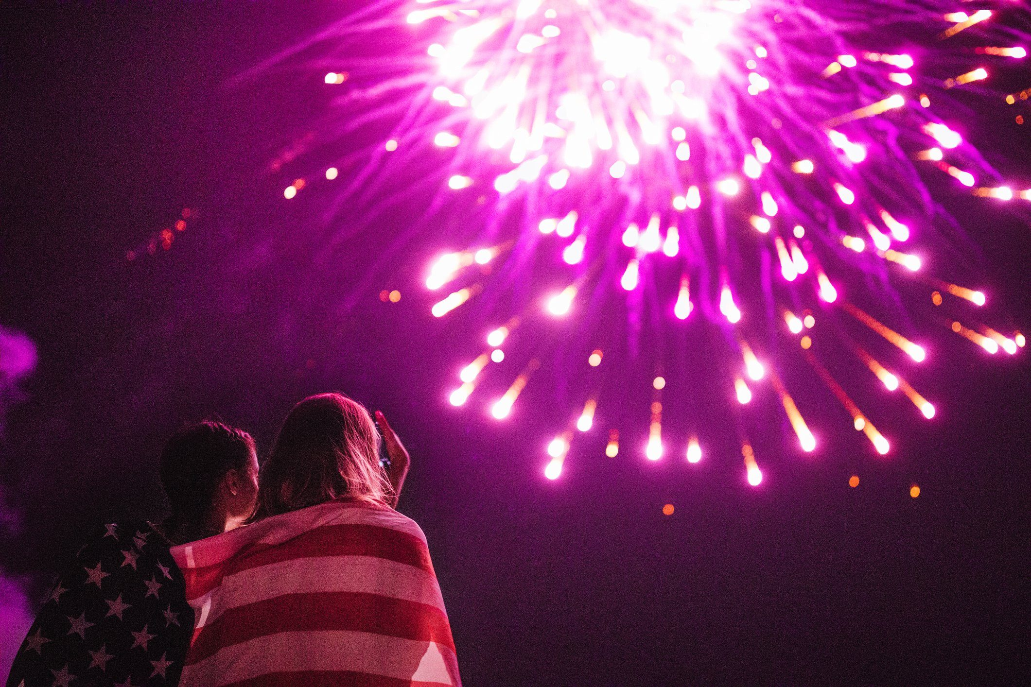 two girls watching fireworks