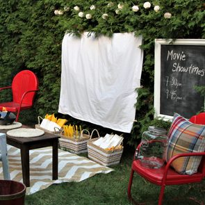 Set up for watching a movie outdoors with food and chairs