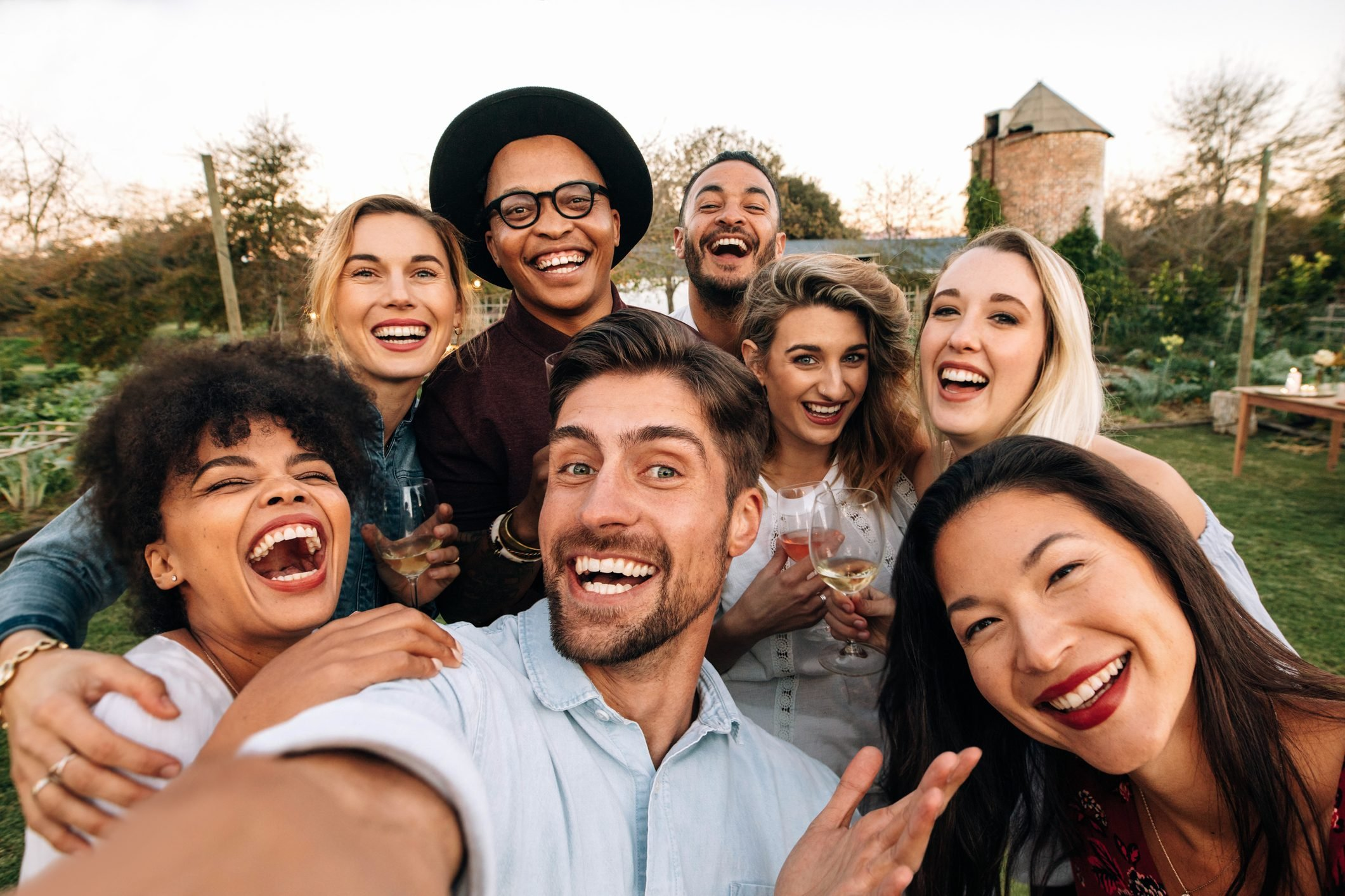 Friends making a selfie together at party